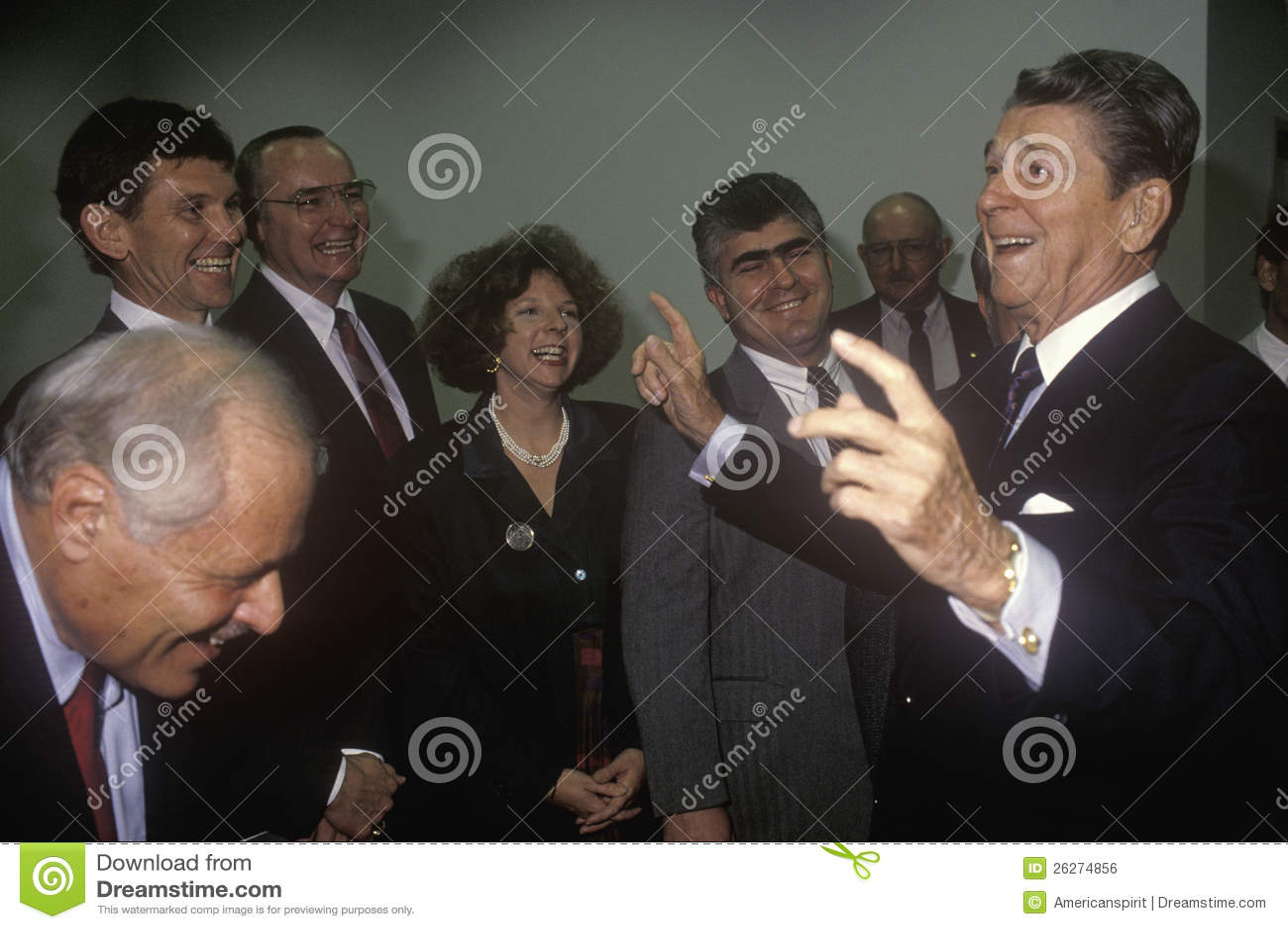 President Ronald Reagan jokes with politicians