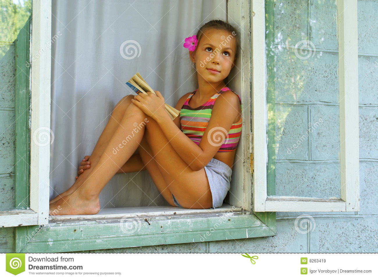 Royalty Free Stock Images: Preteen girl with book