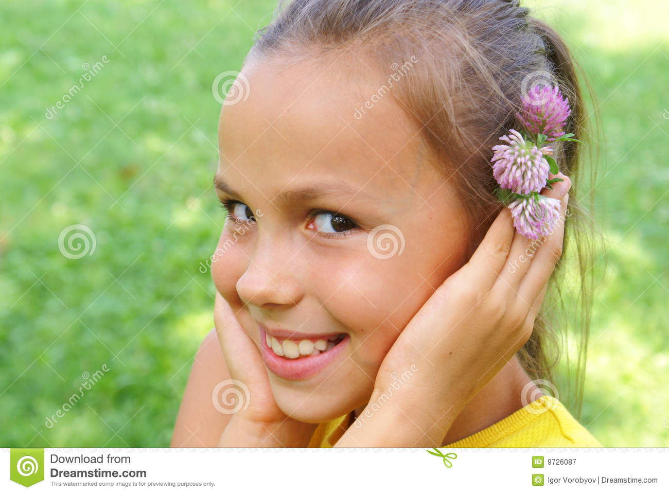 Preteen girl with clover flower