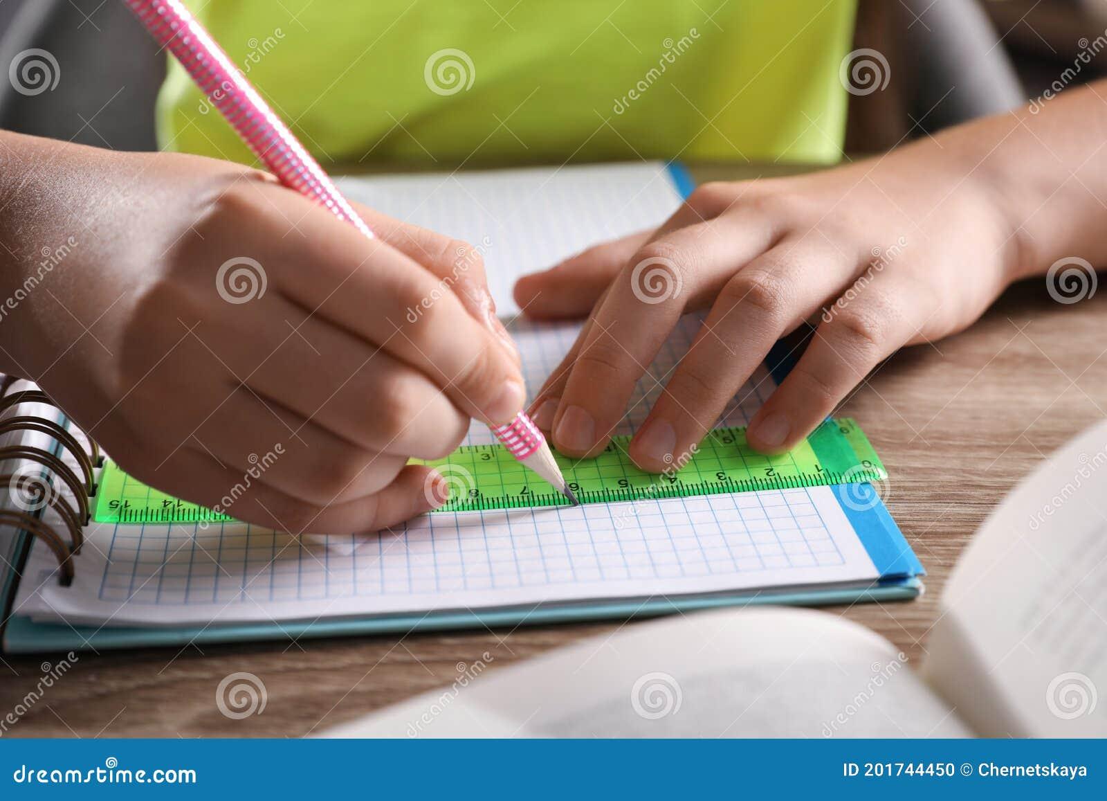 Smart Girl Studying And Doing Homework Stock Photo