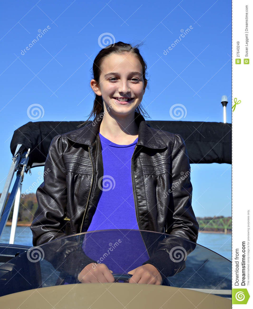 Preteen Girl Learning to Drive a Boat