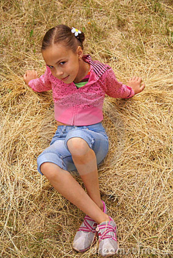 Young girl grass stock photo. Image of female, holiday