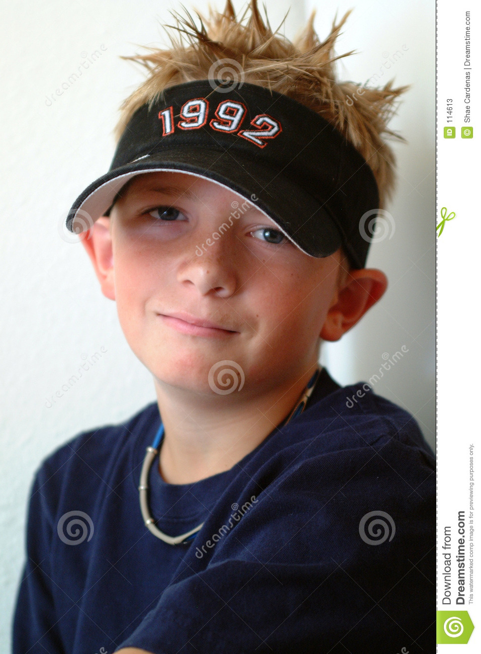 Preteen boy with spiked blond hair.