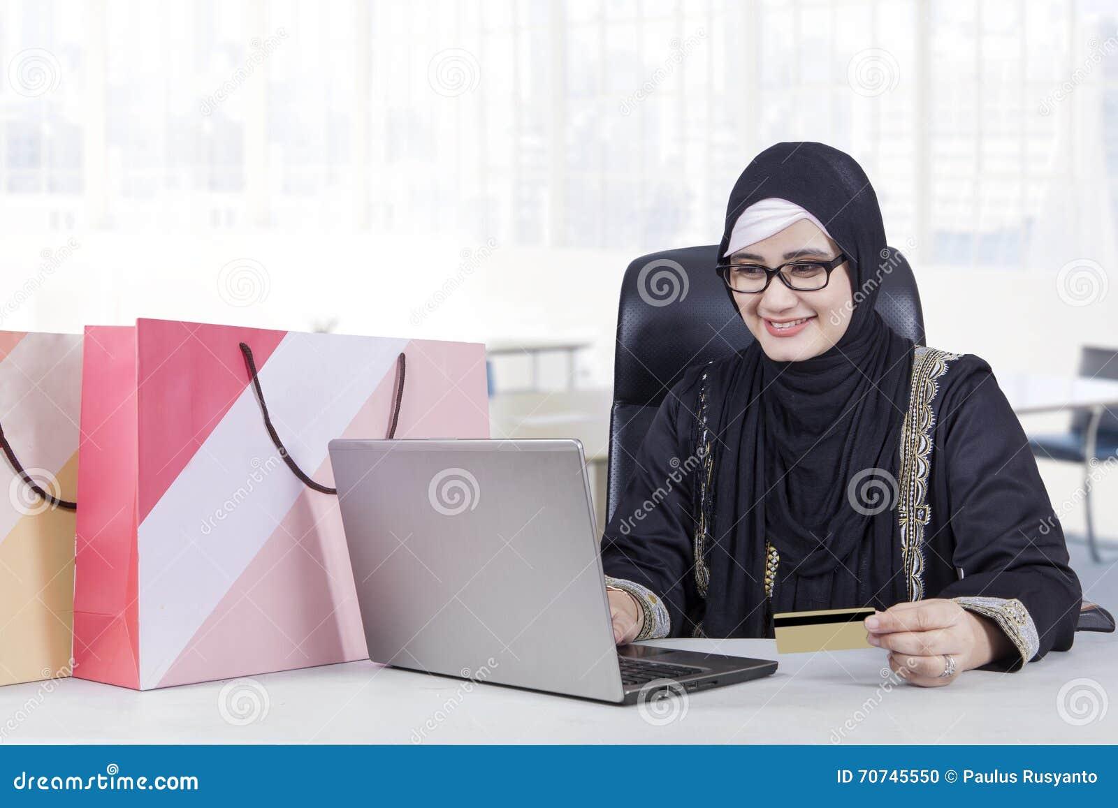 Pretty Arabic woman shopping online