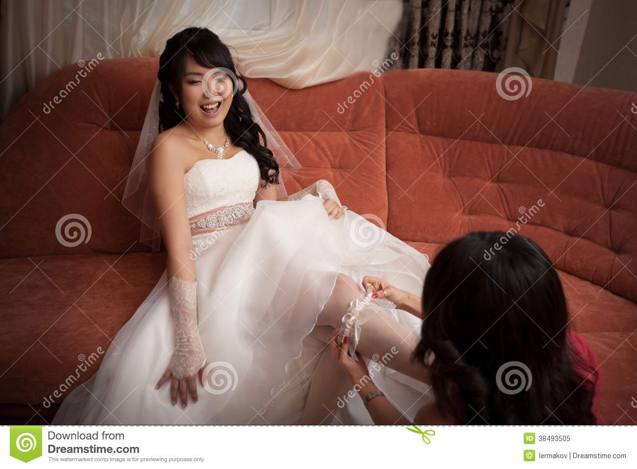 Asian garter wedding