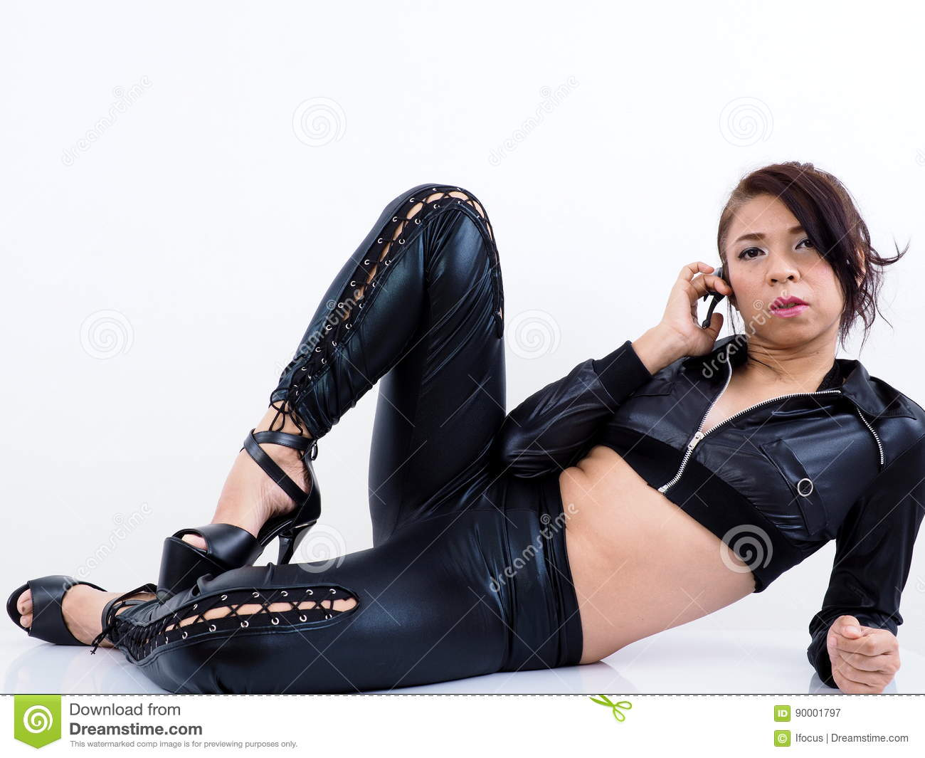 pretty asian model wearing clothes uses mobile phone stock image