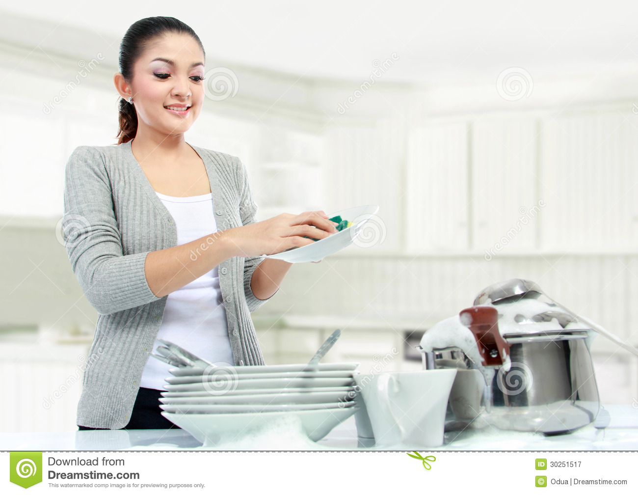 pretty asian woman doing house work washing dishes 30251517