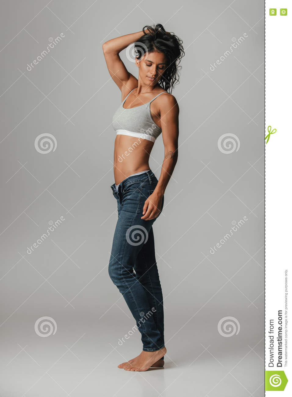 Pretty Athletic Woman With Jeans Strikes A Pose Stock Photo Image