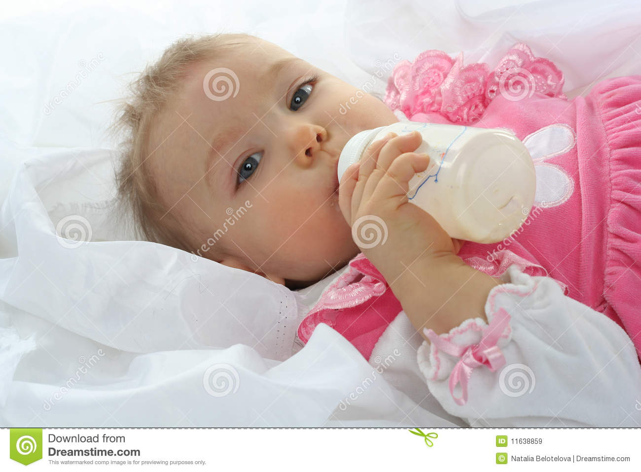 pretty baby girl is drinking milk stock image - image of person