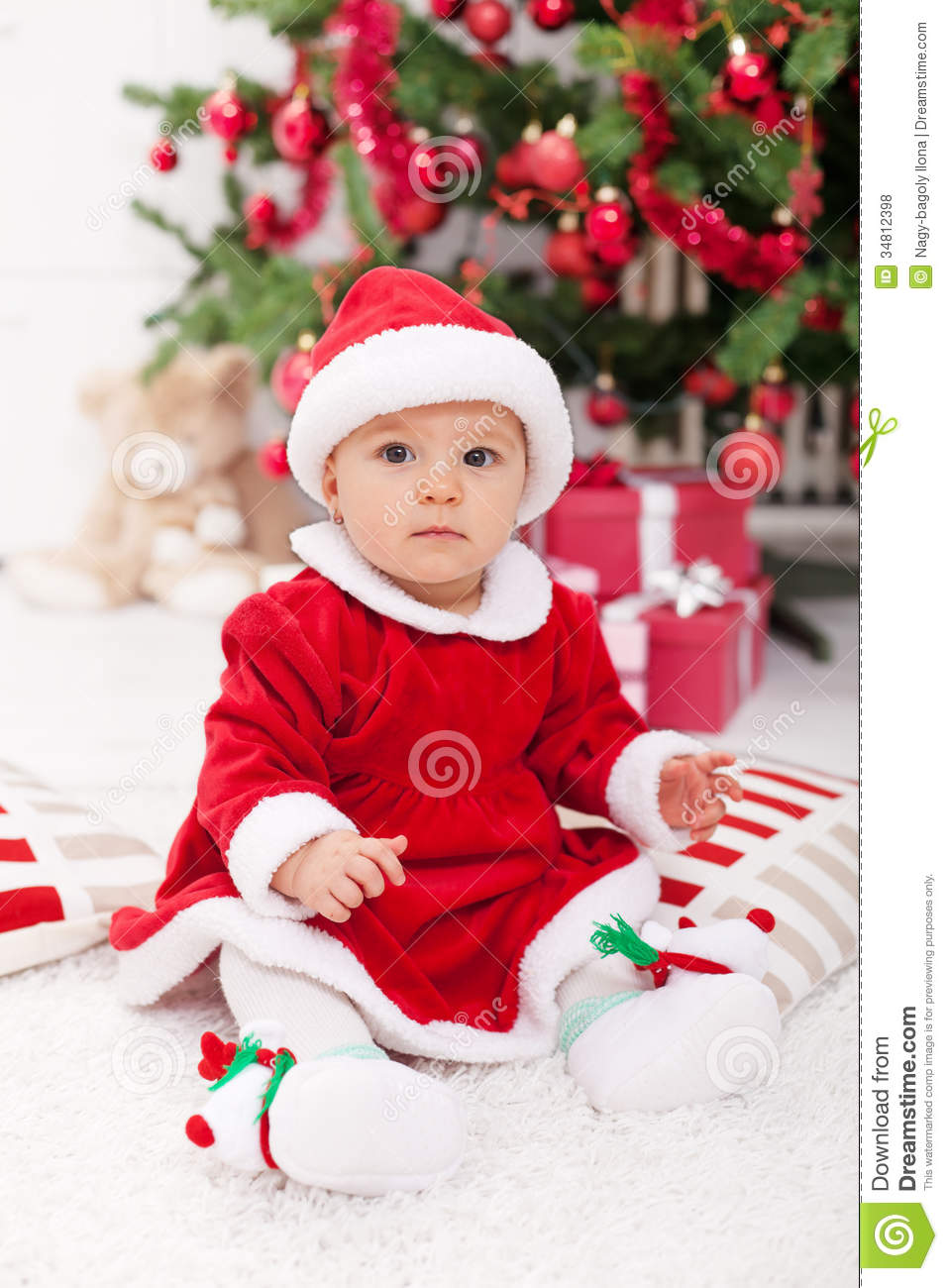 Pretty Baby Girl In Santa Costume Sitting Stock Photo - Image of ...