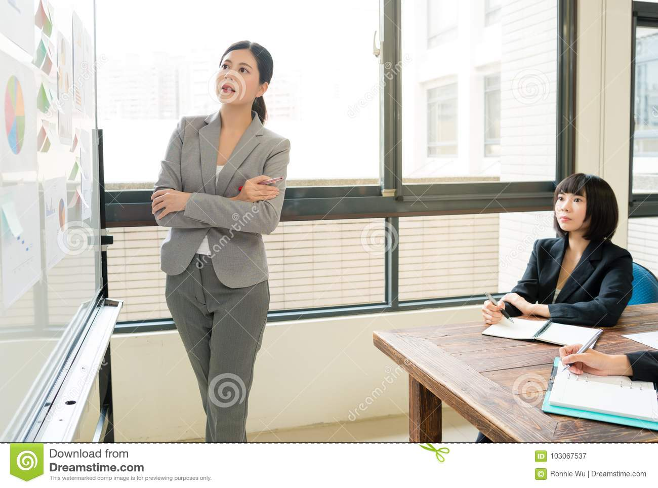 Business woman leader with company employees