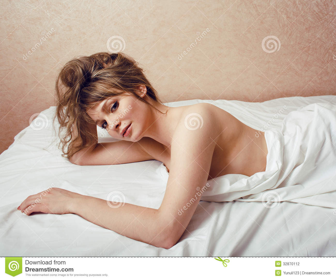 pretty blond woman laying in bed stock photography image 32870112. Black Bedroom Furniture Sets. Home Design Ideas