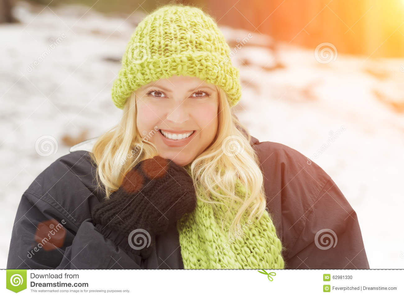Pretty Blonde Woman Wearing Scarf And Hat In The Snow Stock Photo ... 97fe445243c