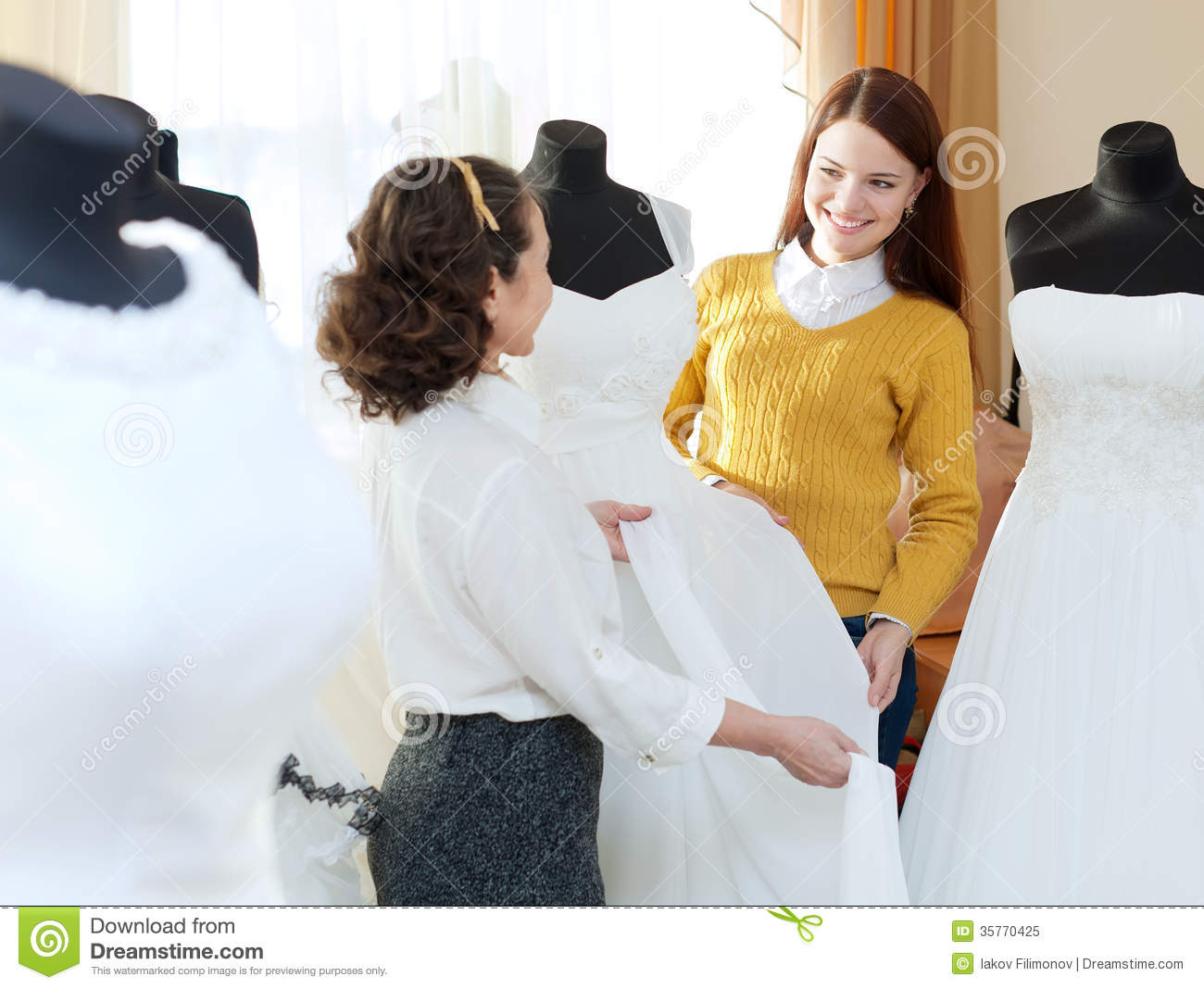 Wedding Photography Consultant: Pretty Bride Chooses Bridal Dress Stock Image