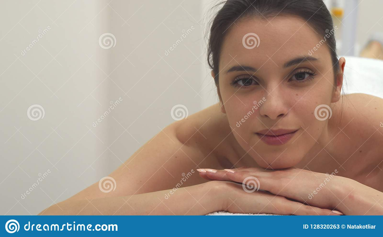 Girl relaxes on the massage table