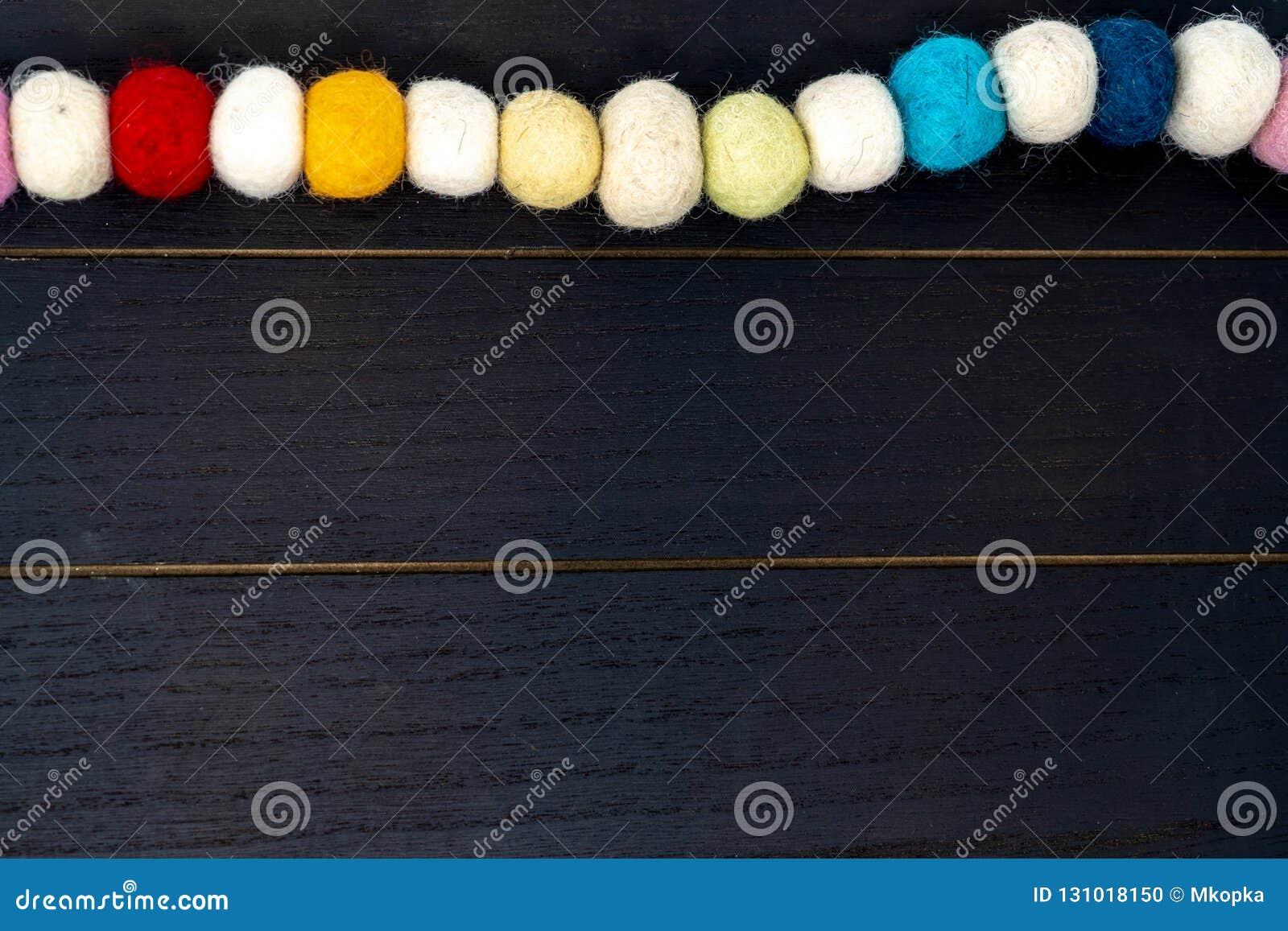 Pretty Colorful Rainbow Pom Pom Fabric Garland Over Black Wood Backdrop Stock Photo Image Of Festive Black 131018150