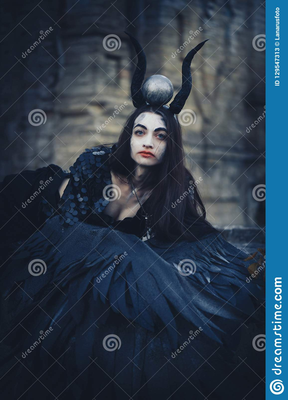 e22a51a3f Pretty Demon Girl With Black Wings Behind Her Back