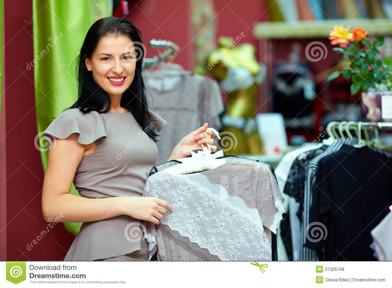 Royalty Free Stock Photos: Pretty elegant woman in clothing store