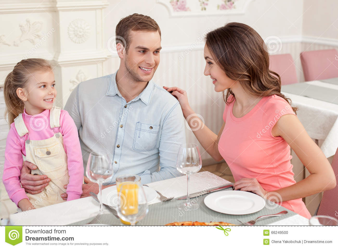 Pretty family has a lunch in cafe