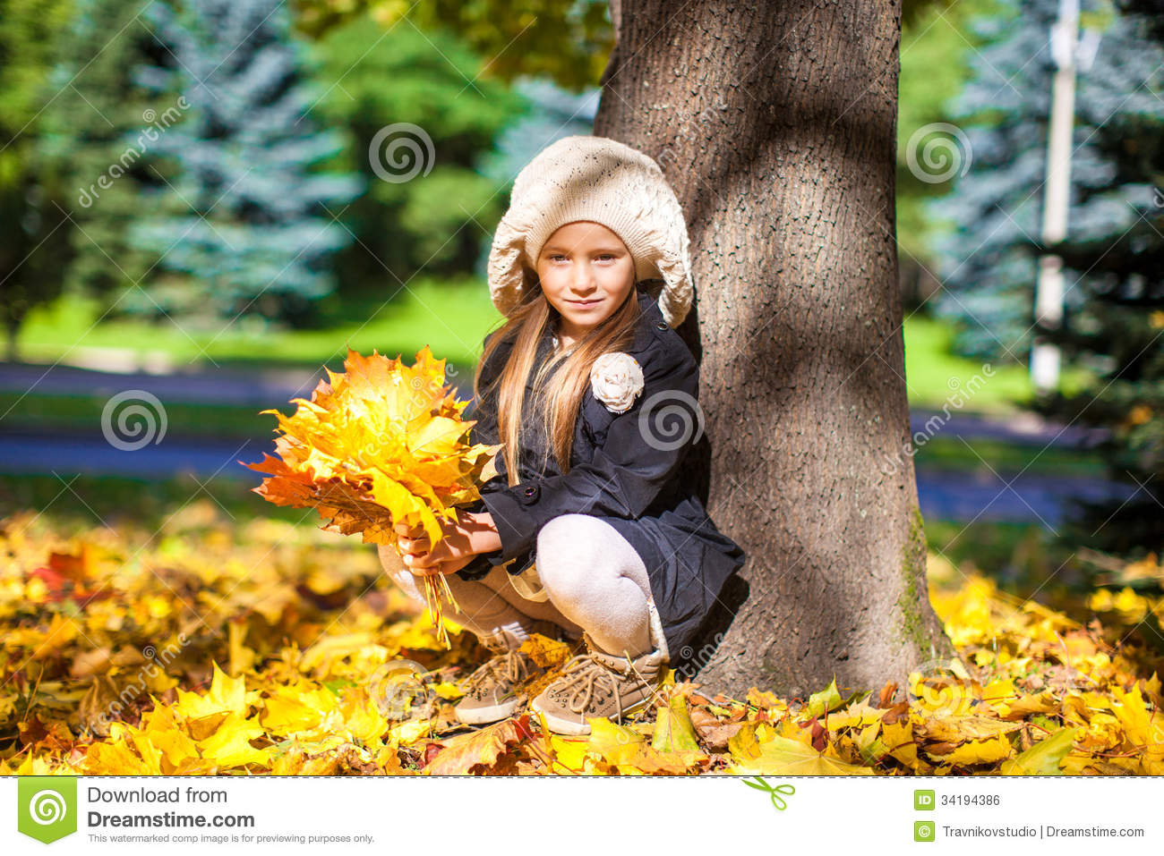 Beautiful Smiling Young Girl Sitting Under The Tree Stock ...