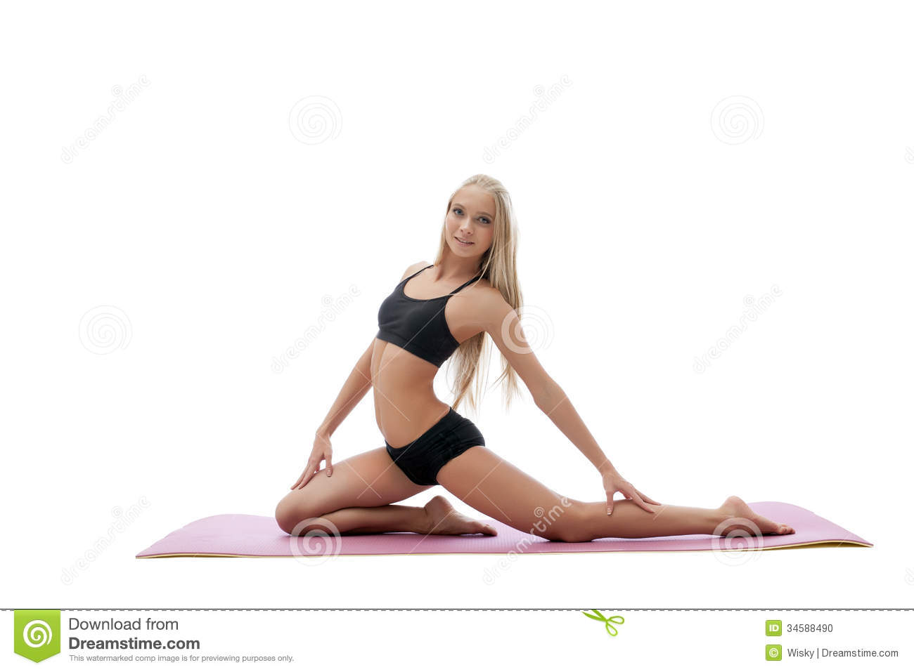 Pretty Fitness Instructor Posing On Gymnastic Mat Stock