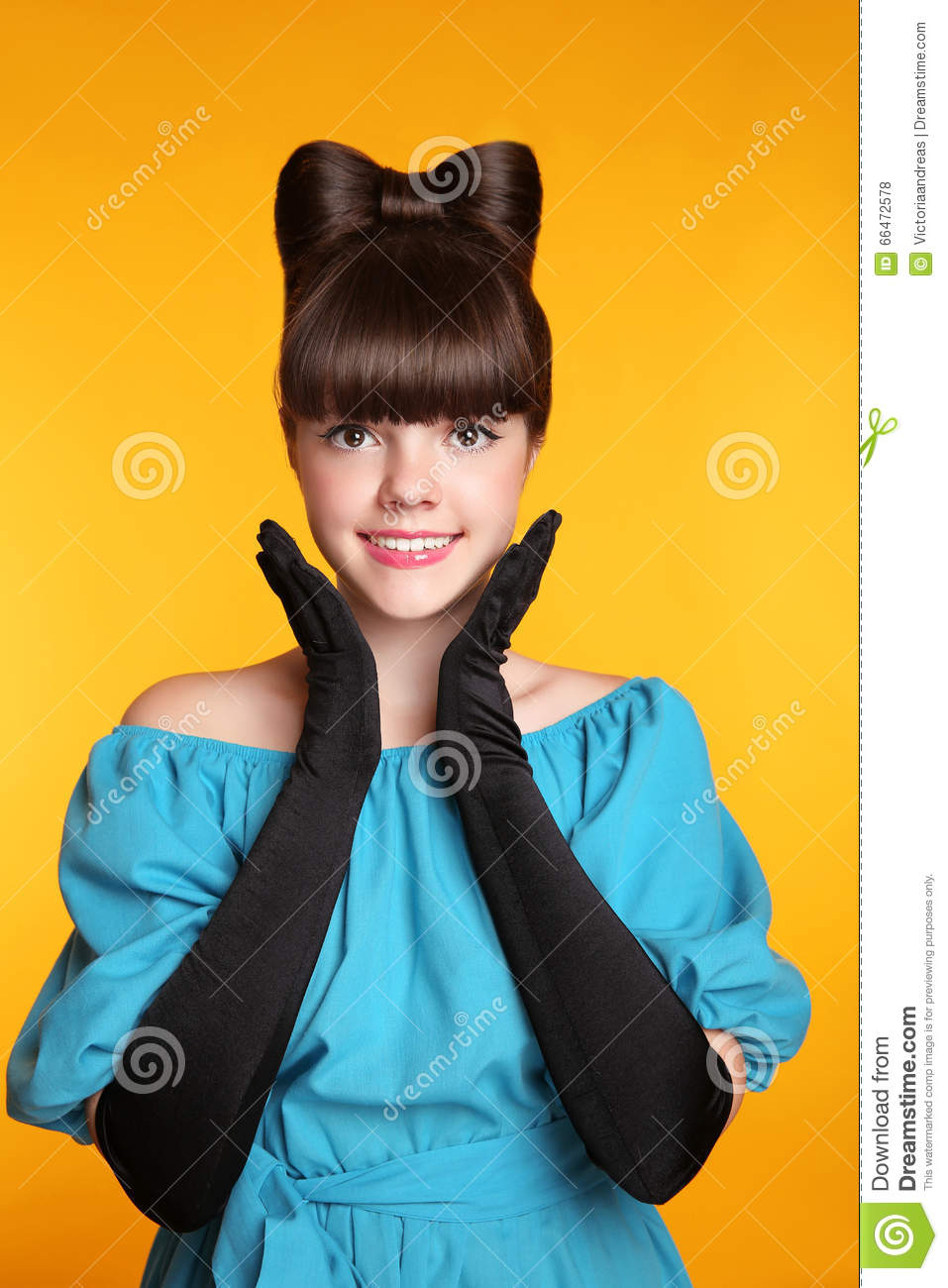 Pretty funny smiling girl beauty portrait. Elegant Fashion Glamorous teen Model wearing black Glamour Gloves. Bow Hairstyle and M