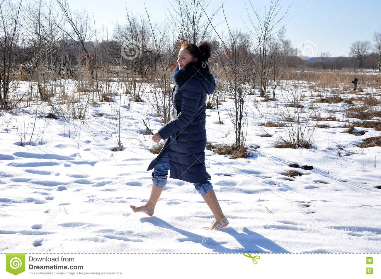 https://thumbs.dreamstime.com/z/pretty-girl-barefoot-walking-snow-cute-young-brunette-blue-winter-coat-fur-sunny-cold-winter-day-natural-white-80547163.jpg