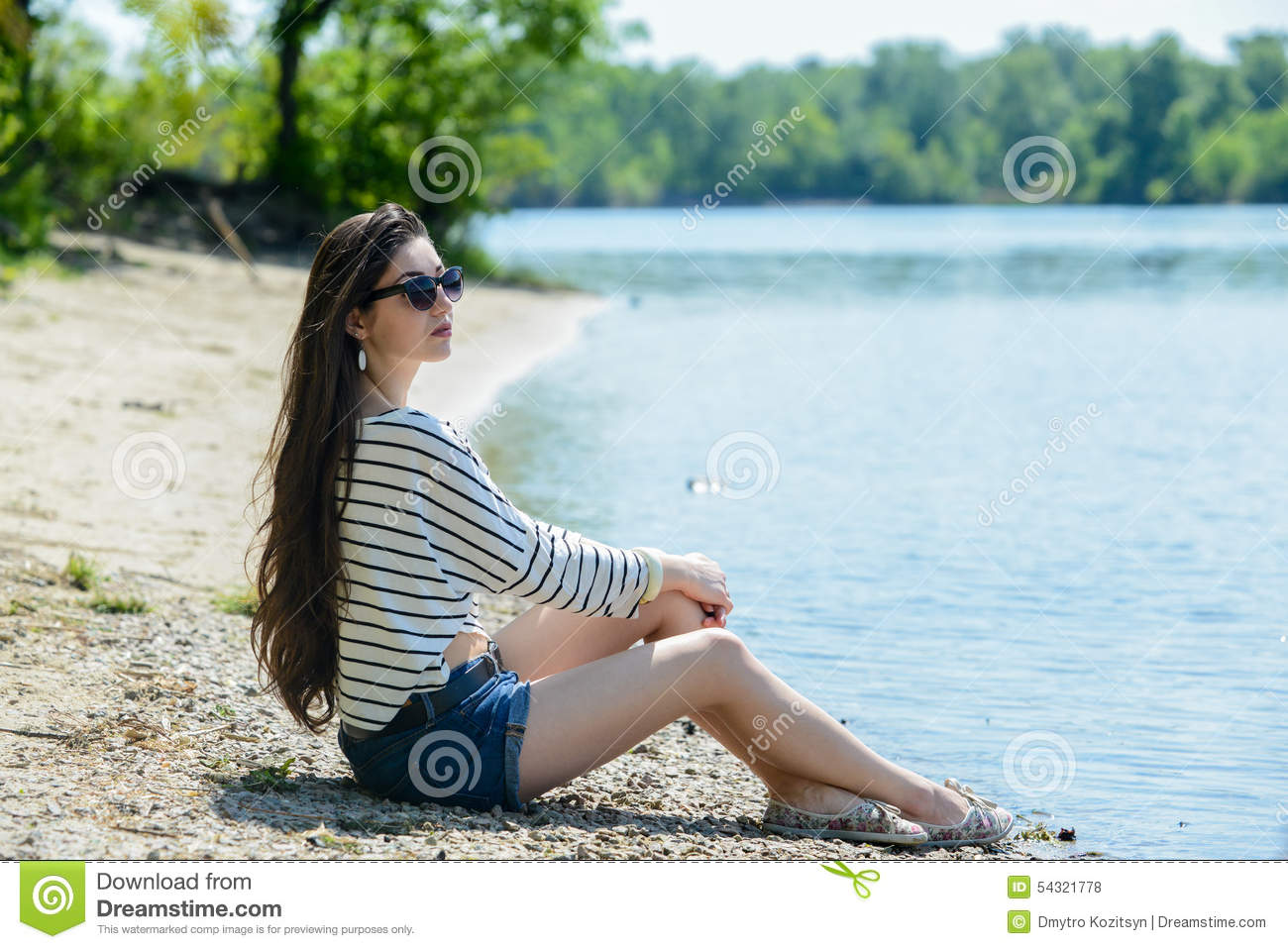 Pretty Girl On The Beach Look At Water Stock Photo
