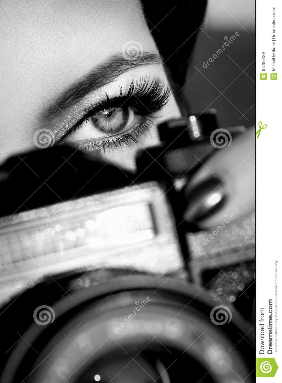 Pretty girl with beautiful eyes make pictures in a city park black and white photo