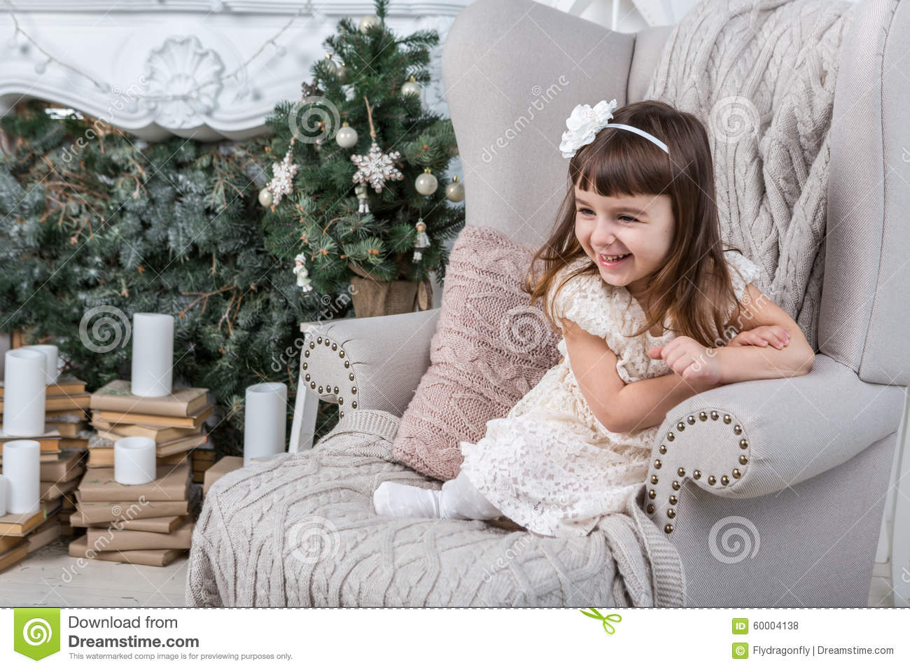 Pretty girl in chair stock photo image 60004138 for Sitting easy chairs