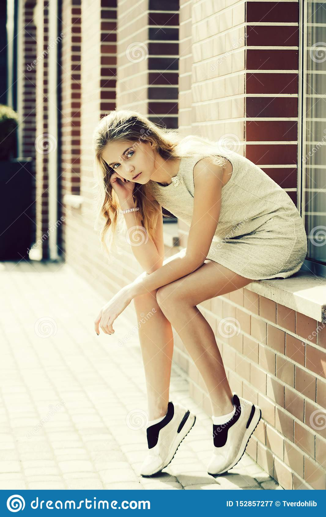 Pretty Girl In Dress And Sport Shoes