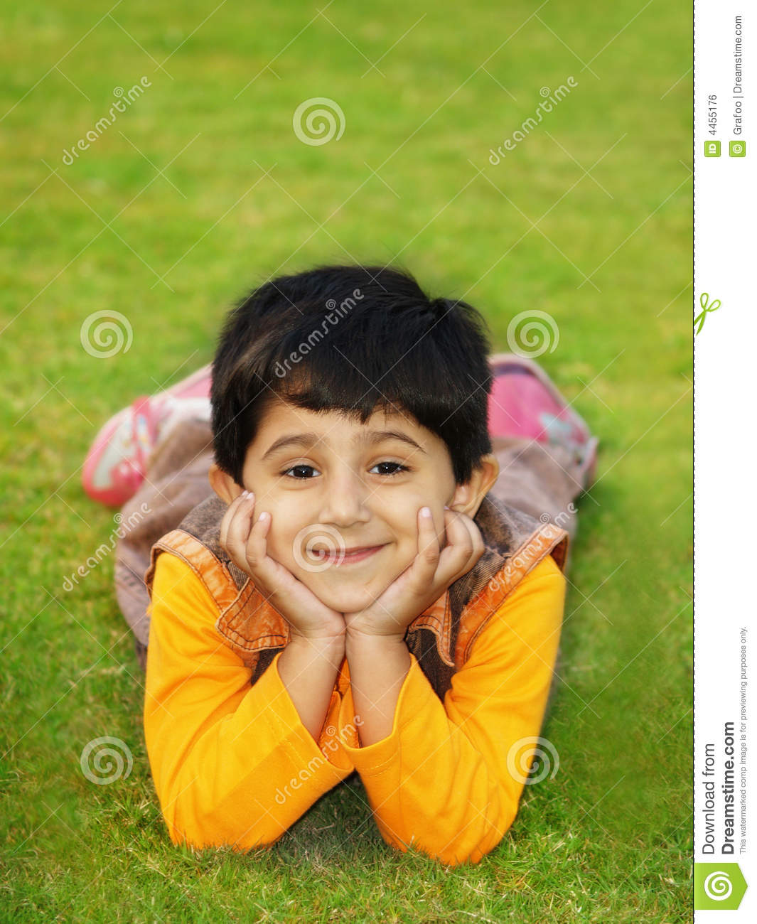 Girl smiles laying on grass royalty free stock image for Pretty grass