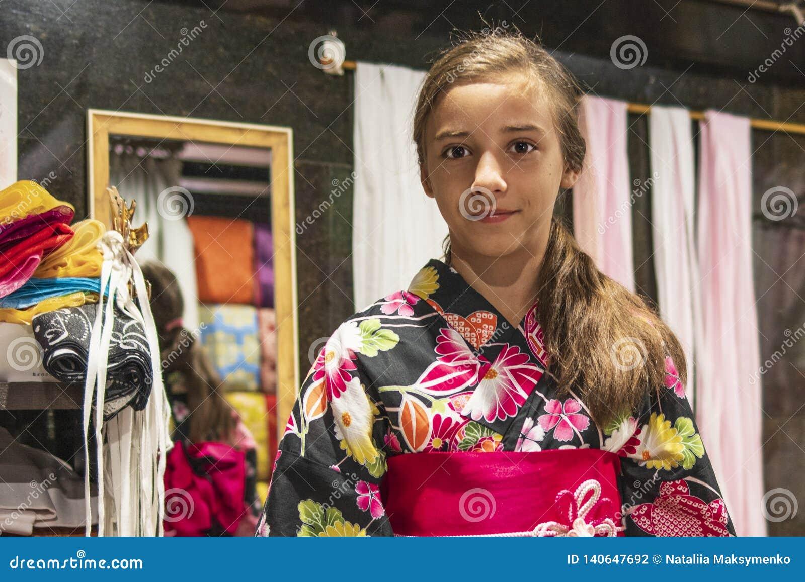 609d2494aacd8 A Pretty Girl In A Kimono. Kimono Is The Traditional Dress Worn ...