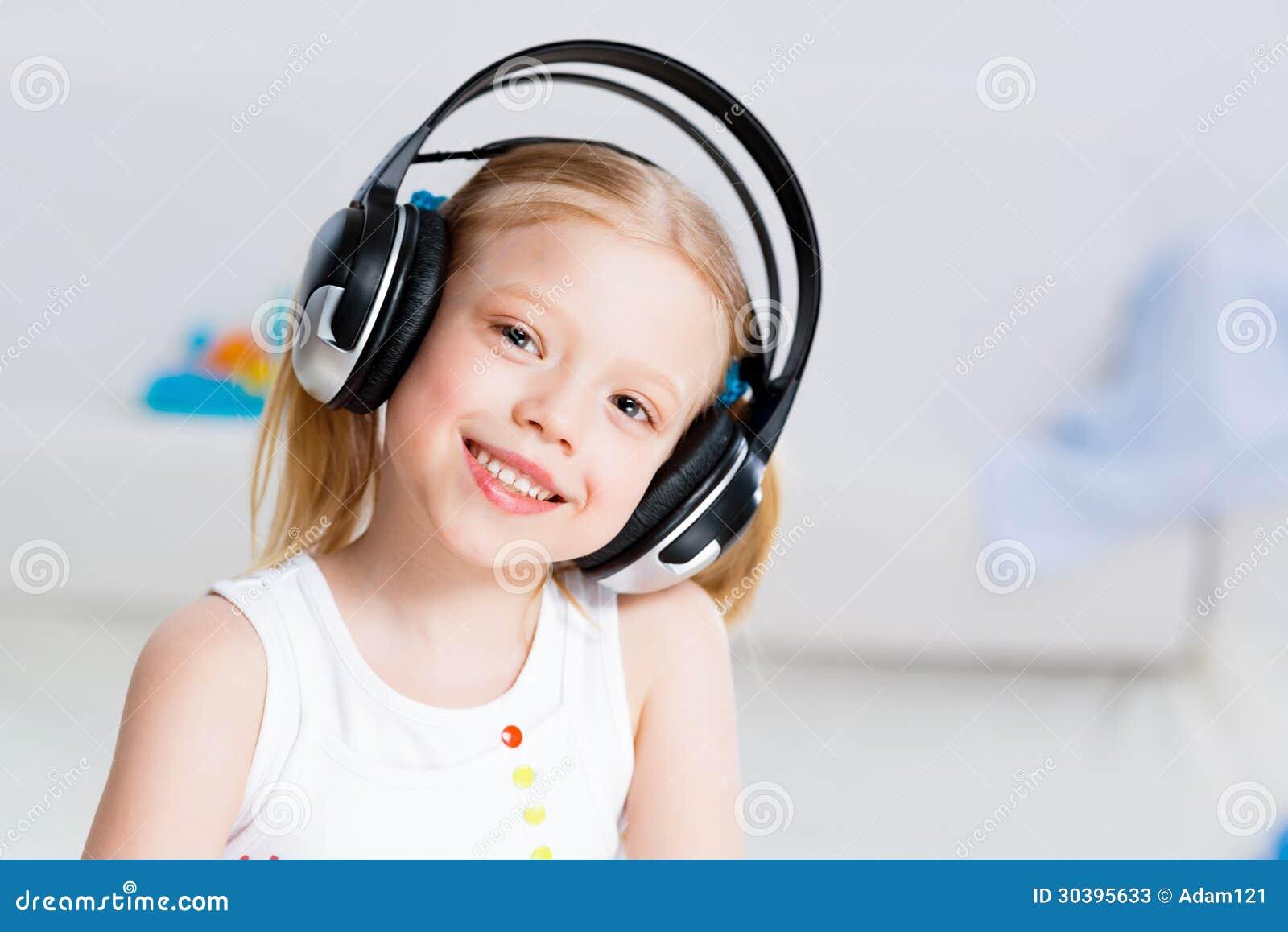 Girl Listening To Music In Living Room