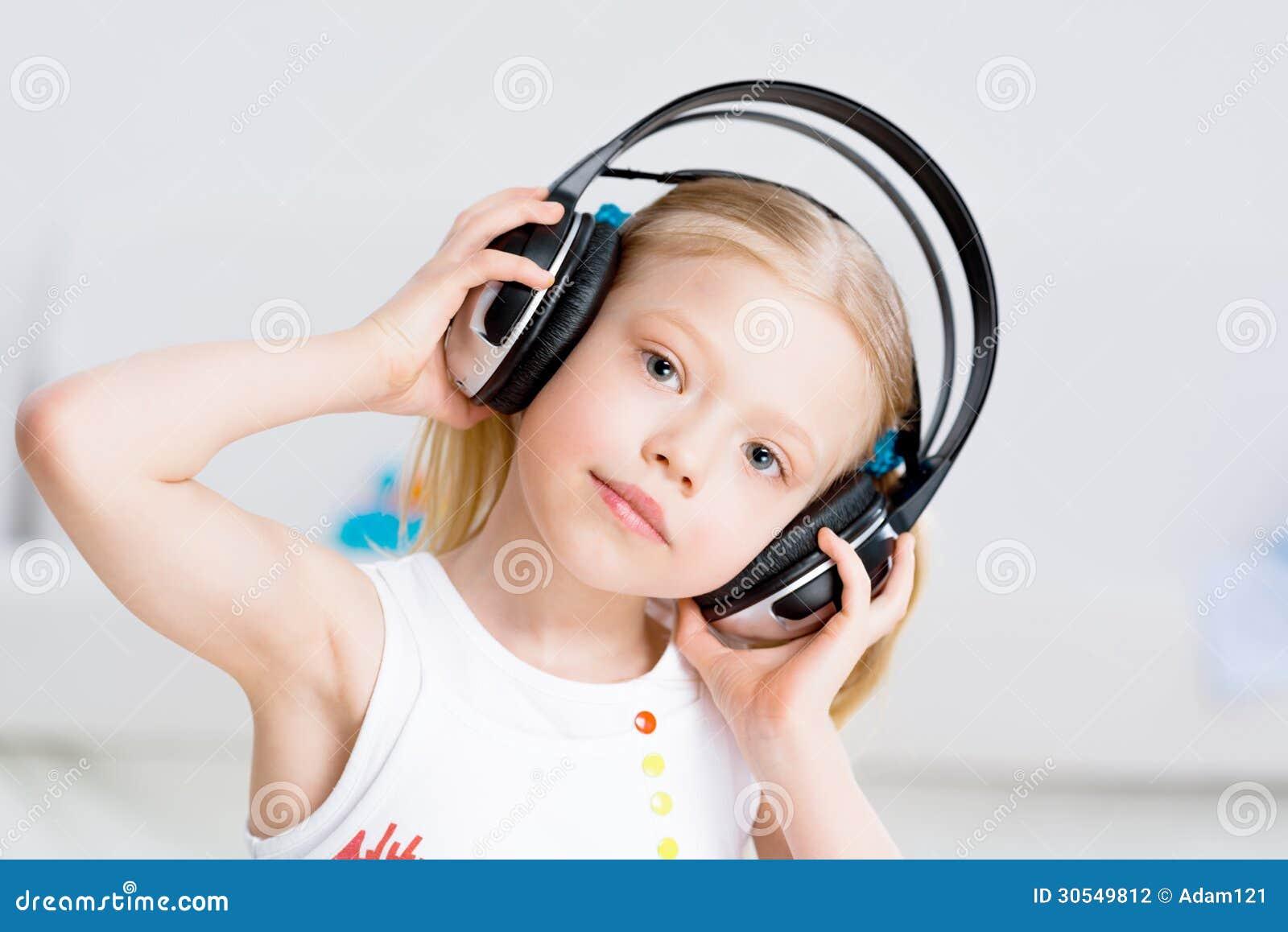 Pretty Girl Listening To Music On Headphones Stock ...