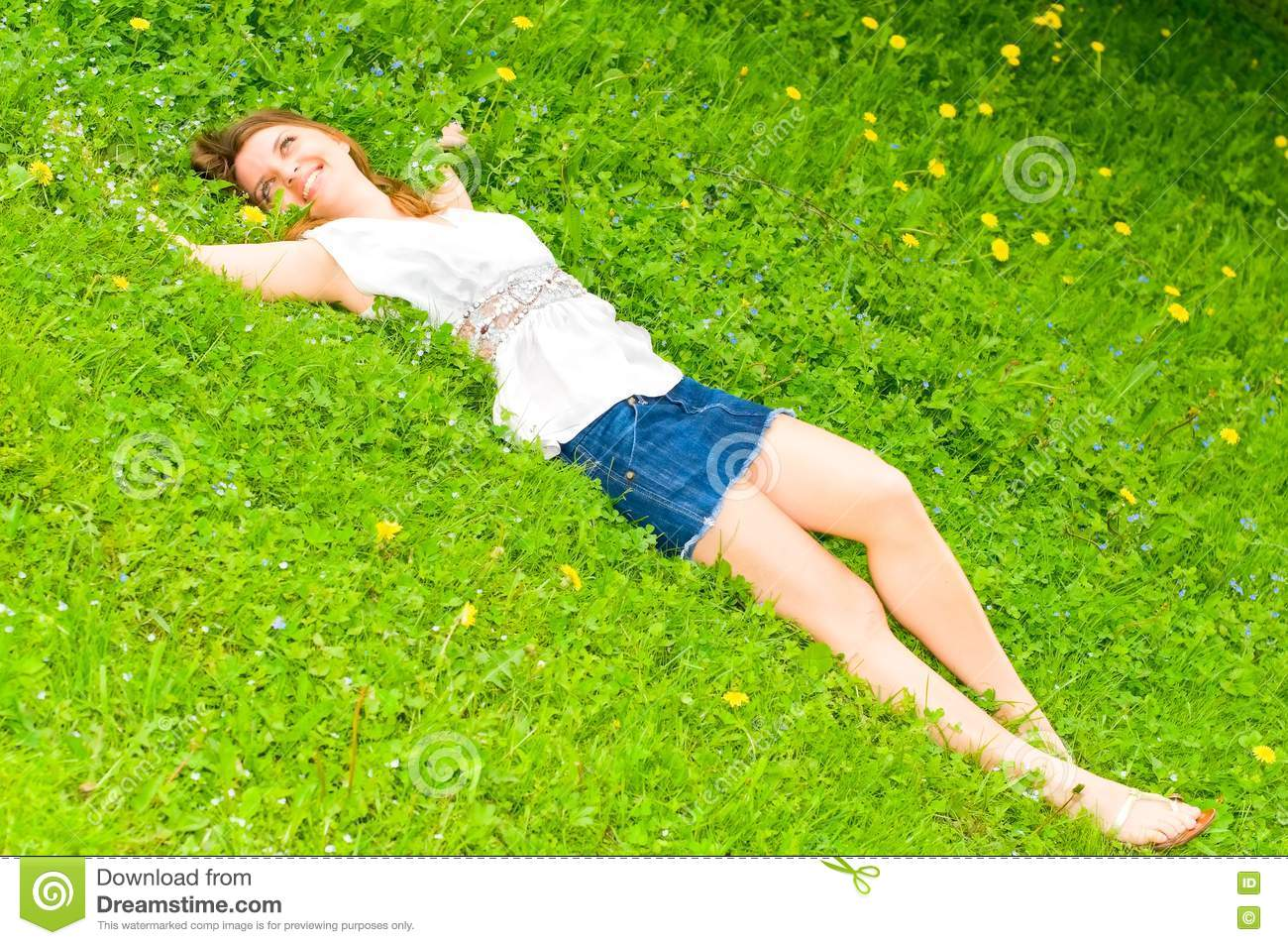 Pretty girl lying on grass royalty free stock image for Pretty grass