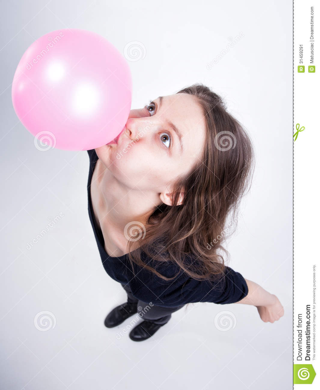 Pretty girl making chewing gum balloons