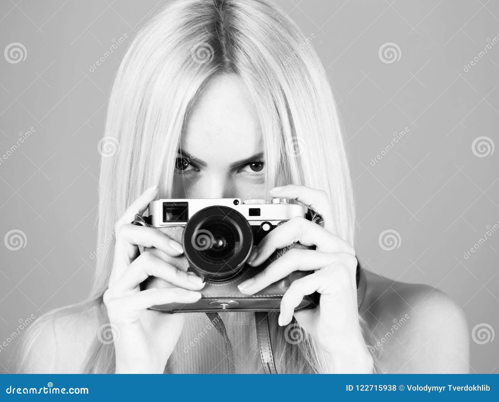 08052c8e920ca Pretty Girl Photographer Photographing With Retro Camera Stock Photo ...