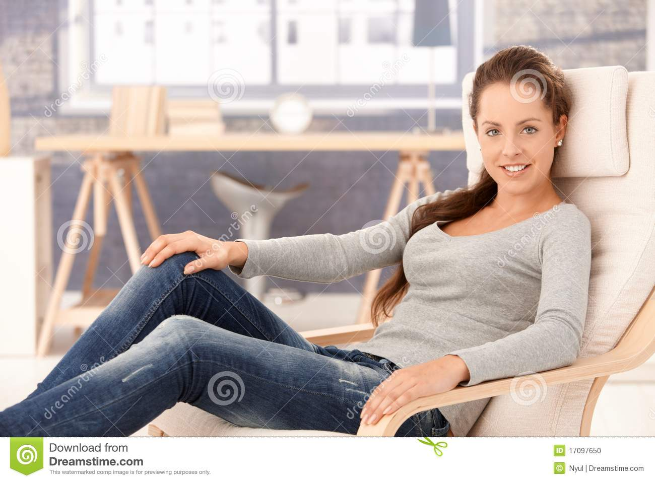 Pretty Girl Relaxing At Home In Armchair Smiling Stock