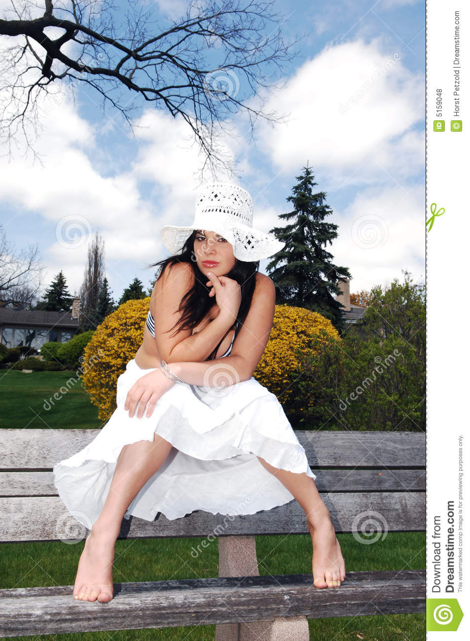 Pretty Girl Sitting On The Bench Royalty Free Stock