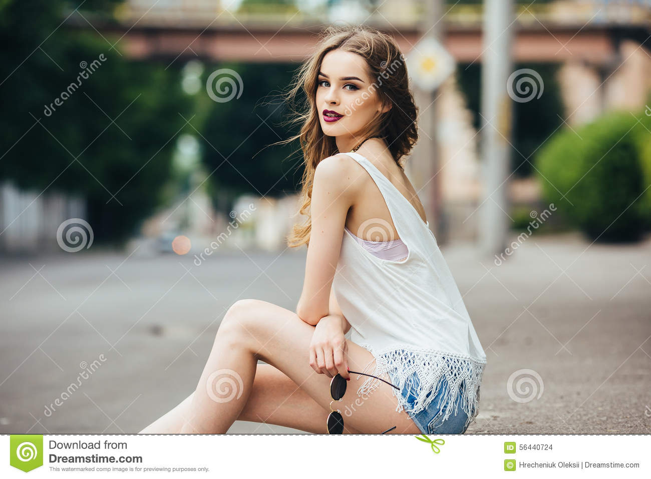 Pretty Girl Sitting In A City Street Stock Image ...