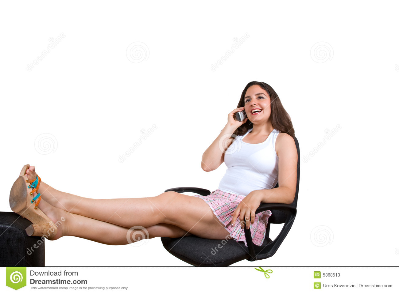 Pretty Girl Smiling With Telephone In Office Chair Stock