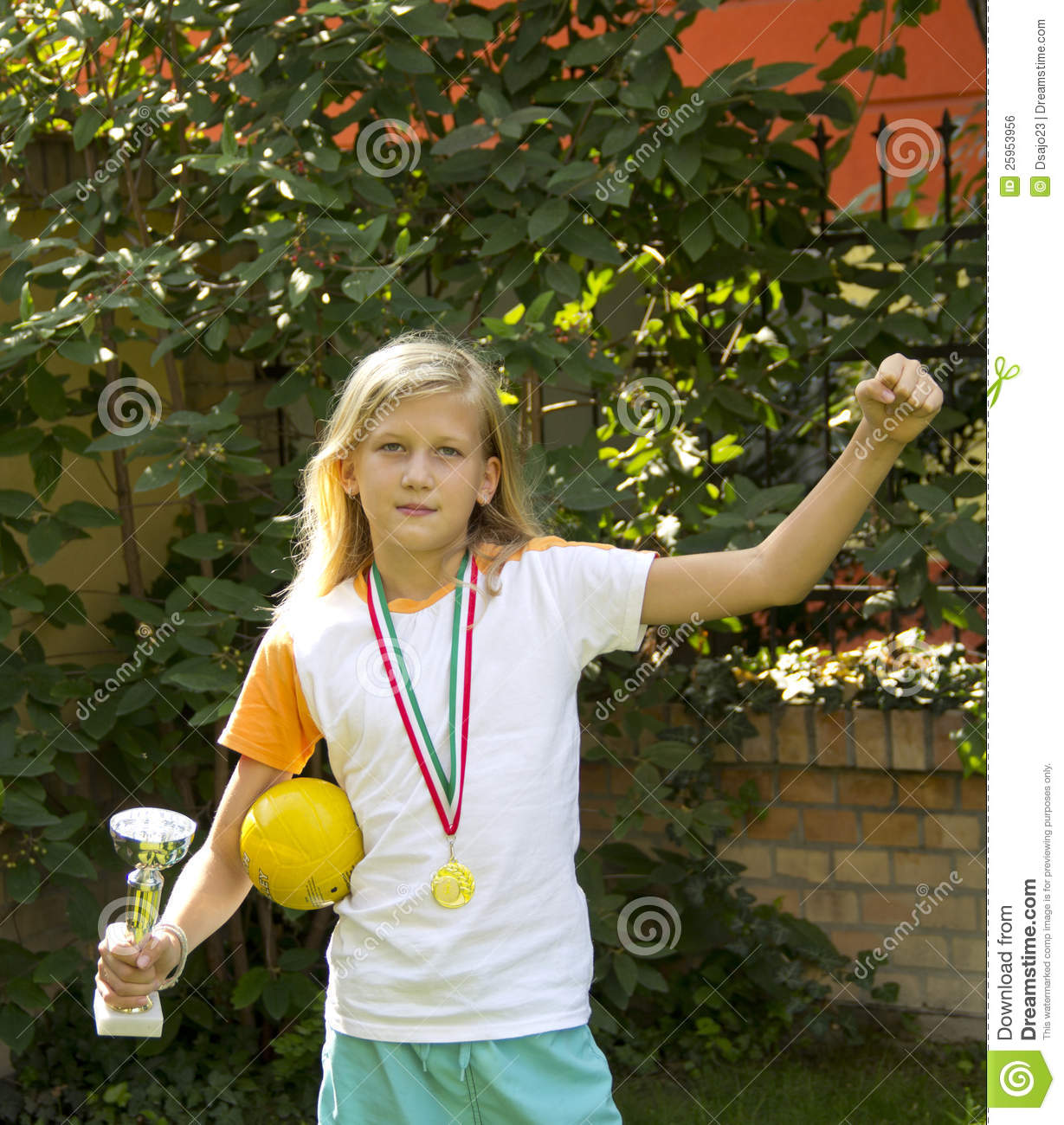 Pretty Girl With Sports Medal And Cup Royalty Free Stock