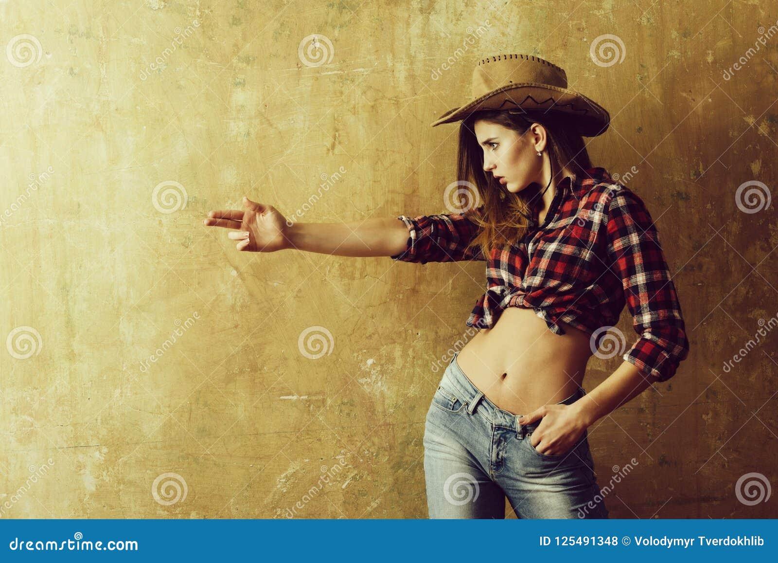 Pretty Girl In Stylish Cowboy Hat Showing Finger Gun Stock Photo ... 53f3621ae34