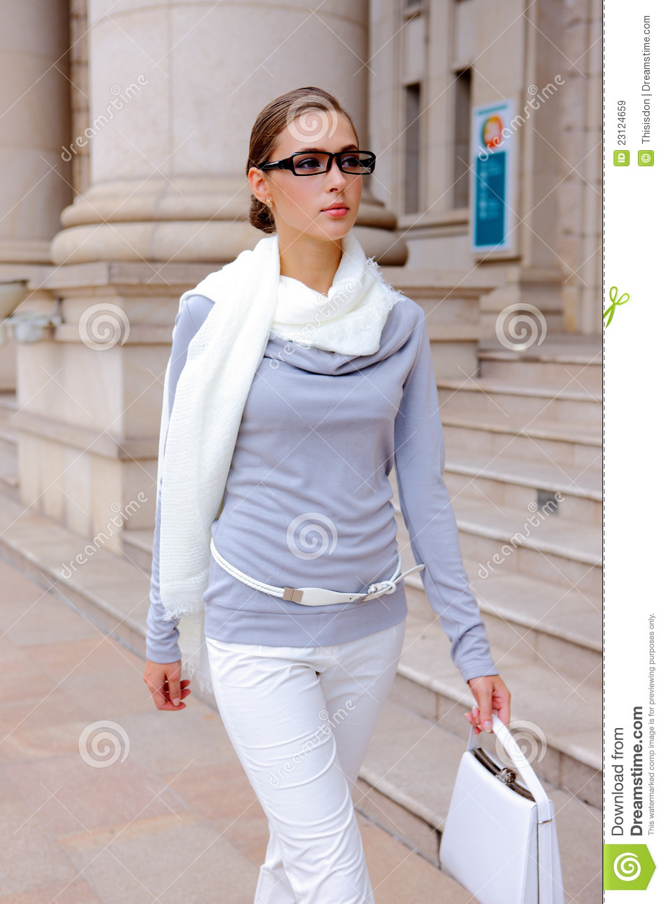 Pretty girl walking down the street with bag