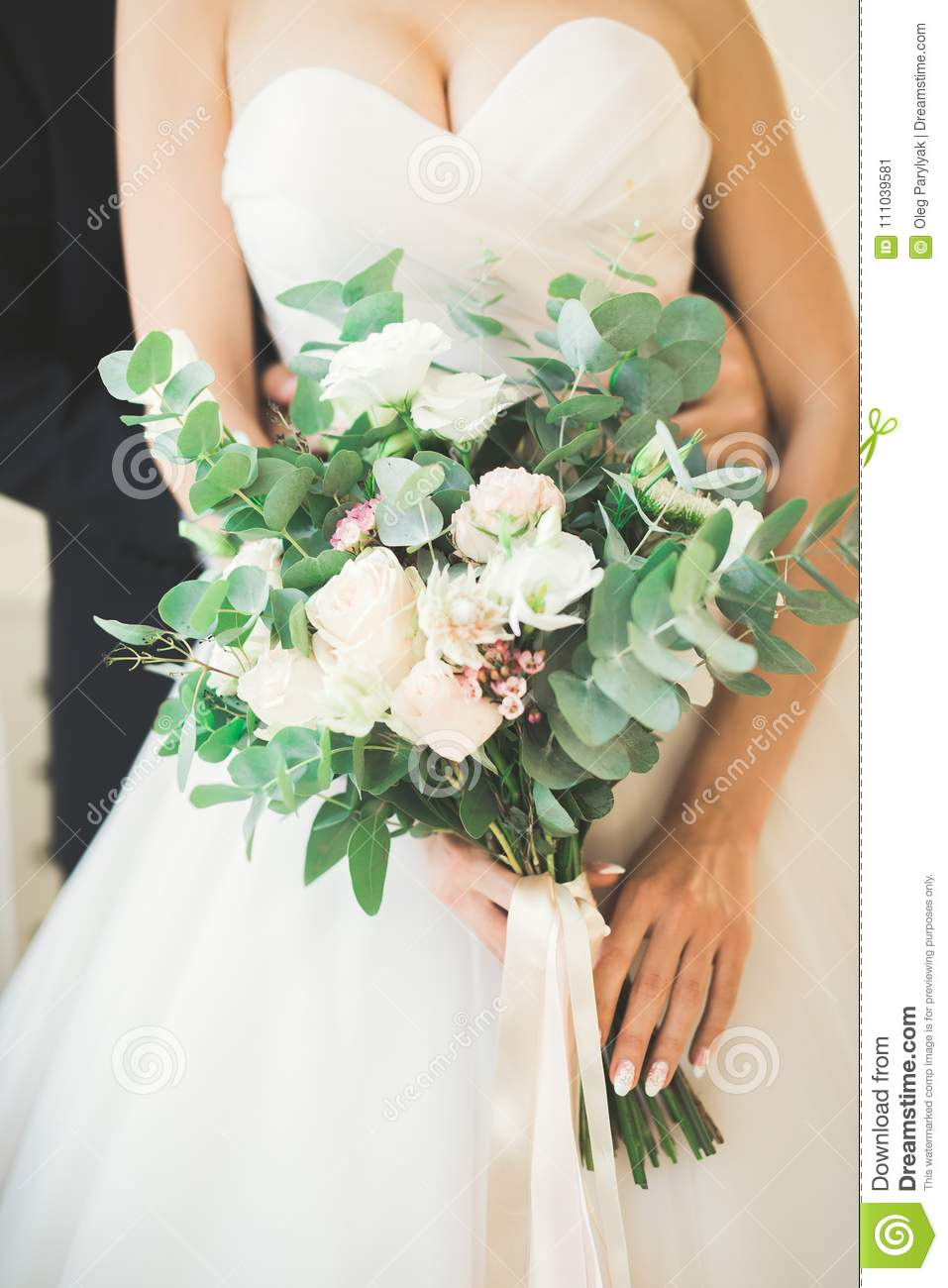 Pretty Good Wedding Bouquet Of Various Flowers In Hand Stock Image