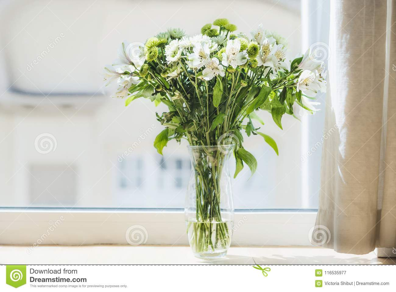 Pretty Green Flowers Bunch In Vase At Window Home Interior Stock