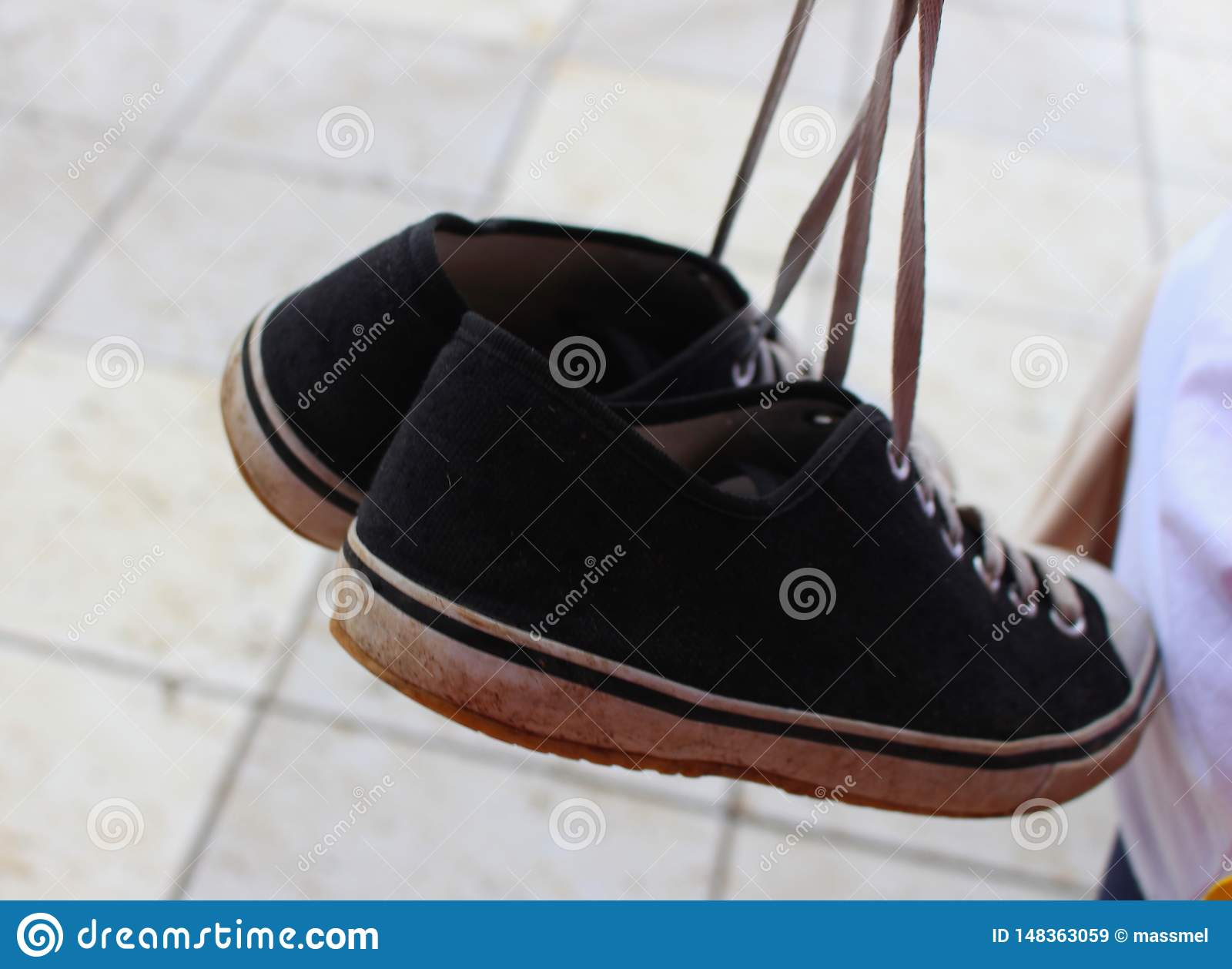 Pair of filthy black sneakers