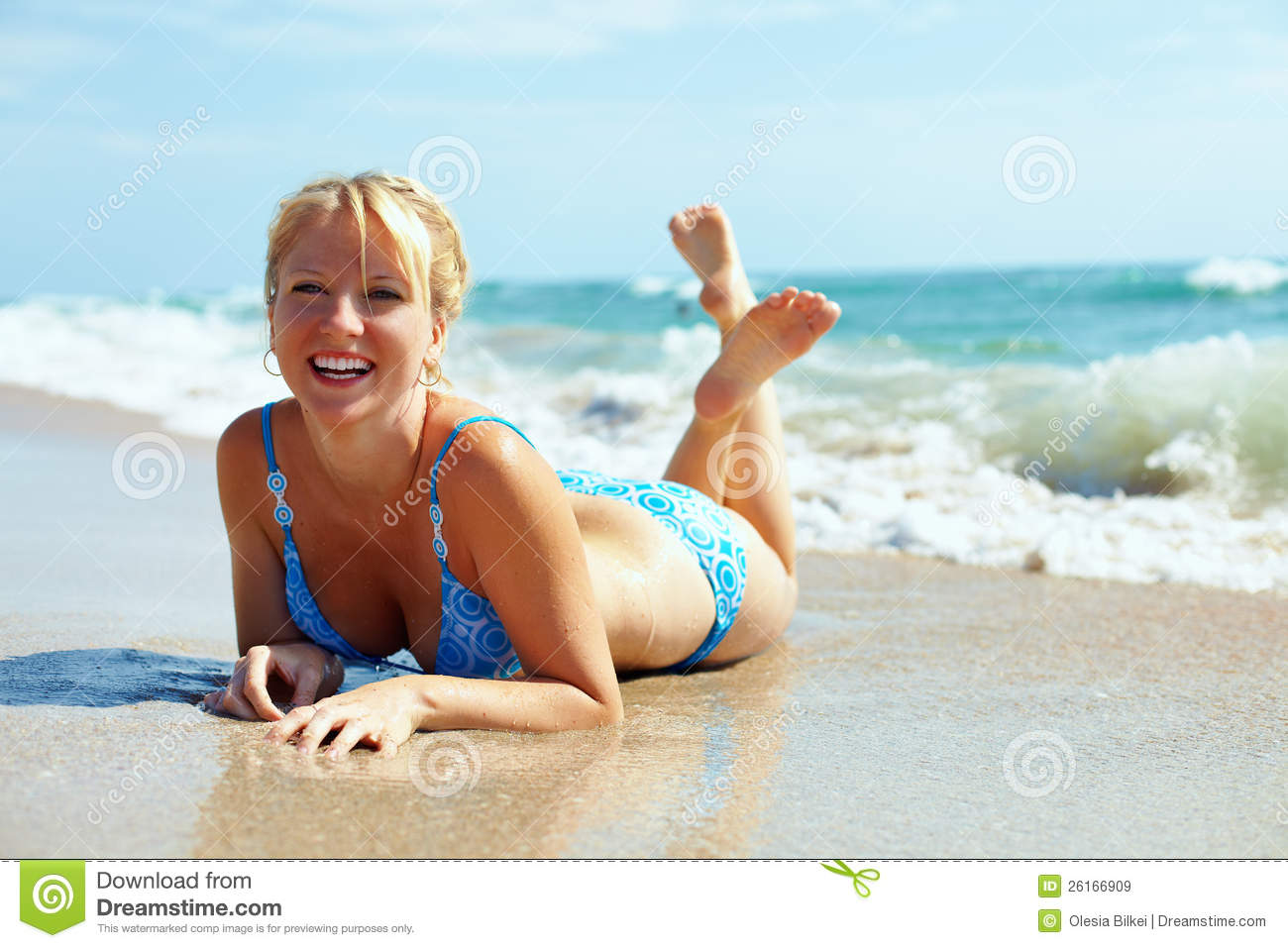Pretty Happy Girl Lying In Surf On The Beach Stock Image