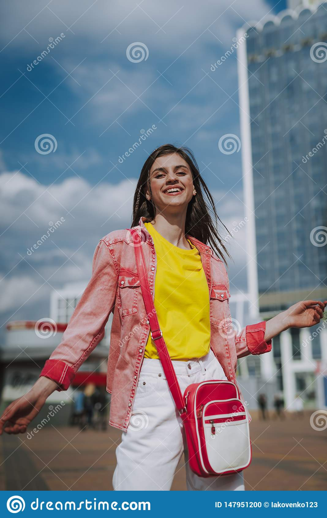 Pretty hipster girl posing on city view